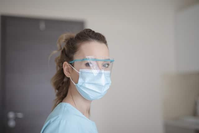 woman-in-blue-shirt-wearing-face-mask-3881247